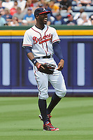 Atlanta Braves right fielder Jason Heyward #22 warms up between innings during a game against the Colorado Rockies at Turner Field on September 3, 2012 in Atlanta, Georgia. The Braves  defeated the Rockies 6-1. (Tony Farlow/Four Seam Images).