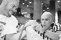 """Richard Calero competes at the Empire State Finals at the Port Authority Bus Terminal in New York City on November 17, 2005.  The Empire State Finals is the culmination in the year of the New York City Arm Wrestling Association's """"Golden Arm Series""""."""