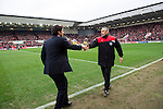 Bristol City 1 Middlesbrough 0, 16/01/2016. Ashton Gate, Championship. Aitor Karanka shakes hands with interim manager John Pemberton before Bristol City take on Championship leaders Middlesbrough. Ashton Gate is located in the south-west of the city, it currently has an all-seated capacity of 16,600, due to redevelopment, which will increase to a capacity of 27,000 by the start of the 2016-17 season. Bristol City won the game one goal to nil with a headed injury time winner. Photo by Simon Gill