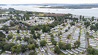 BNPS.co.uk (01202) 558833. <br /> Pic: BNPS<br /> <br /> Pictured: Holiday homes at Rockley Park at Rockley Point in Poole Harbour, Dorset. <br /> <br /> There are fresh calls for a holiday park to increase safety measures at a notorious beach where one swimmer has drowned and almost 20 children rescued this summer. <br /> <br /> In the latest incident a dad and his two young sons were plucked to safety in the nick of time after they were swept away by a rip tide at Rockley Park in Poole Harbour, Dorset.<br /> <br /> It happened a month after hero swimmer Callum Baker-Osborne, 18, drowned while helping to rescue 13 children at the same spot.<br /> <br /> And before that two young girls were saved from drowning by a paddleboarder.