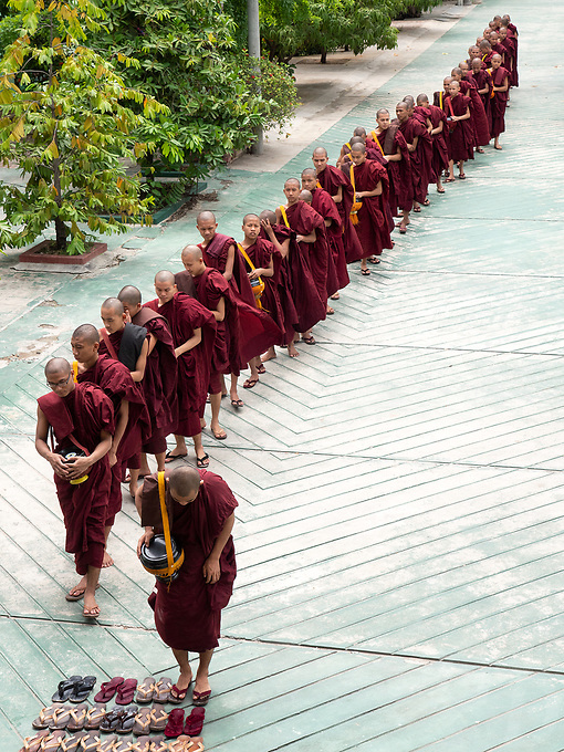 A Monastery in Sagaing, Mandalay, Myanmar Buddhist Monks lining up before their daily 11 AM lunch