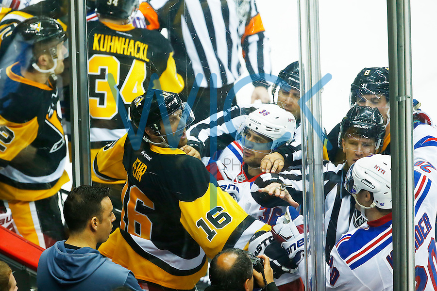 Eric Fehr #16 of the Pittsburgh Penguins gets tangled with Mats Zuccarello #36 and Chris Kreider #20 of the New York Rangers along the boards in a scrum in the third period during game two of the first round of the Stanley Cup Playoffs at Consol Energy Center in Pittsburgh, Pennsylvania on April 16, 2016. (Photo by Jared Wickerham / DKPS)