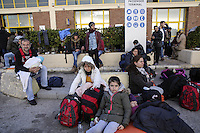 Pictured: Young families of migrants by the passenger terminal Friday 26 February 2016<br /> Re: Hundreds of refugees that crossed the border from Turkey to the Greek islands, have arrived at the port of Piraeus near Athens, Greece