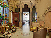 Rocking chairs furnish the Inner Garden, which features an immense stained glass window depicting a floral paradise, the other side of which is the grand marble staircase