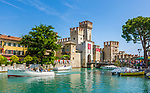 Italy, Lombardia, Sirmione, located on a small peninsula on the South Banks of Lake Garda: Scaliger Castle at entrance to Old Town (Centro Storico) | Italien, Lombardei, Gardasee, Sirmione, auf einer Halbinsel am Suedufer des Gardasees gelegen: Skaligerburg am Eingang zur Altstadt (Centro Storico)