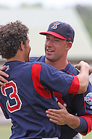Right fielder Ryan Kalish of the Salem Red Sox hugging shortstop Kris Negron after praying  in the outfield before a game against  the Myrtle Beach Pelicans on May 3, 2009
