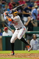 Baltimore Orioles outfielder Adam Jones #10 at bat during the Major League Baseball game against the Texas Rangers on August 21st, 2012 at the Rangers Ballpark in Arlington, Texas. The Orioles defeated the Rangers 5-3. (Andrew Woolley/Four Seam Images).