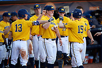Michigan Wolverines Jimmy Kerr (15) congratulated by teammates during a game against Army West Point on February 17, 2018 at Tradition Field in St. Lucie, Florida.  Army defeated Michigan 4-3.  (Mike Janes/Four Seam Images)
