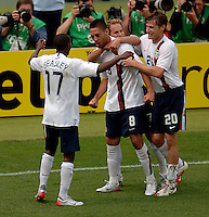 DaMarcus Beasley (17), Clint Dempsey (8), Eddie Lewis (7), and Brian McBride (20), celebrate Dempsey's goal that tied the game at 1-1 in the 43rd minute. Ghana defeated the USA 2-1 in their FIFA World Cup Group E match at Franken-Stadion, Nuremberg, Germany, June 22, 2006.