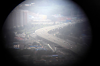 CHINA. Beijing. Raised highways in central Beijing, seen through binoculaurs from the top of the CCTV communications tower. 2009