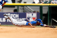 Kansas City Royals shortstop Alcides Escobar #2 dives for a ball up the middle during a game against the Chicago White Sox at U.S. Cellular Field on August 14, 2011 in Chicago, Illinois.  Chicago defeated Kansas City 6-2.  (Mike Janes/Four Seam Images)