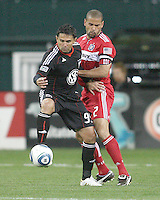 Jaime Moreno #99 of D.C. United holds off C.J. Brown #2 of the Chicago Fire during an MLS match on April 17 2010, at RFK Stadium in Washington D.C. Fire won the match 2-0.