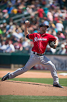Tacoma Rainiers relief pitcher Lindsey Caughel (13) delivers a pitch to the plate during a Pacific Coast League against the Sacramento RiverCats at Raley Field on May 15, 2018 in Sacramento, California. Tacoma defeated Sacramento 8-5. (Zachary Lucy/Four Seam Images)
