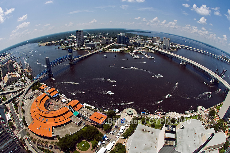 Boat parade on the St. Johns River in front of Jacksonville Landing, between the Acosta and Main Street Bridges - Jacksonville, Florida - helicopter aerial