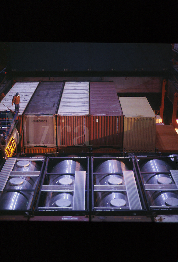 Round bulktainers for shipping liquids which is being off loaded from a ship in the Houston Ship Channel. Houston Texas.