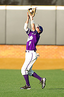 Right fielder Cameron Dullnig #1 of the Western Carolina Catamounts catches a fly ball against the Wake Forest Demon Deacons at Gene Hooks Field on February 22, 2011 in Winston-Salem, North Carolina.  Photo by Brian Westerholt / Four Seam Images