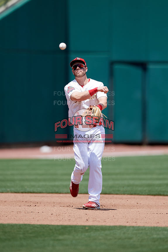 Memphis Redbirds third baseman Patrick Wisdom (5) throws to first base during a game against the Iowa Cubs on May 29, 2017 at AutoZone Park in Memphis, Tennessee.  Memphis defeated Iowa 6-5.  (Mike Janes/Four Seam Images)