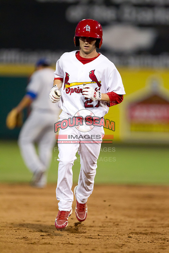Shane Robinson (27) of the Springfield Cardinals heads for third base after hitting a home run during a game against the Tulsa Drillers at Hammons Field on July 19, 2011 in Springfield, Missouri. Tulsa defeated Springfield 17-11. (David Welker / Four Seam Images)