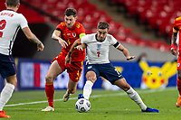 8th Occtober 2020, Wembley Stadium, London, England;  Englands Harry Winks holds off Wales' Ben Davies during a friendly match between England and Wales in London