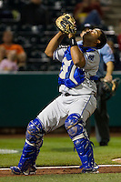 Wilin Rosario (20) of the Tulsa Drillers makes a play on a foul ball during a game against the Springfield Cardinals on April 29, 2011 at Hammons Field in Springfield, Missouri.  Photo By David Welker/Four Seam Images.