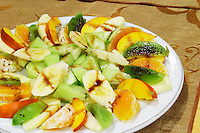 Fruit salad with banana, peach, orange, kiwi. Efendi Efendy traditional Turkish and Ottoman Restaurant, The Block, Tirana. Albania, Balkan, Europe.