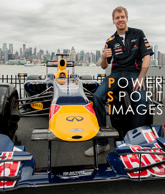 Red Bull Racing driver Sebastian Vettel of Germany during the filming of the 3rd Infiniti's Inspired Performers' series with R&B artist Melanie Fiona of Canada at the Grand Prix Circuit in New Jersey on June 11, 2012, New York, USA. Photo by Victor Fraile / The Power of Sport Images for Infiniti