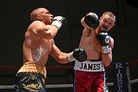 Scott James (red shorts) defeats CJ Wood during a Boxing Show at the Corn Exchange on 25th September 2021