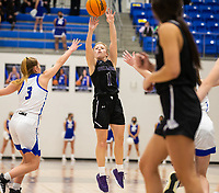 Claudia Bridges (1) of Fayetteville takes the shot  as Camiran Brockhoff (3) of Rogers defending at King Arena, Rogers, AR January 8, 2021 / Special to NWA Democrat-Gazette/ David Beach