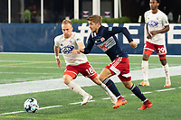 FOXBOROUGH, MA - OCTOBER 16: Justin Rennicks #12 of New England Revolution II pressures Derek Waldeck #18 of North Texas SC during a game between North Texas SC and New England Revolution II at Gillette Stadium on October 16, 2020 in Foxborough, Massachusetts.