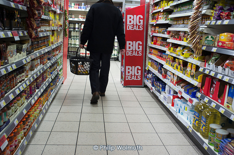 A man shopping in a Co-op supermarket