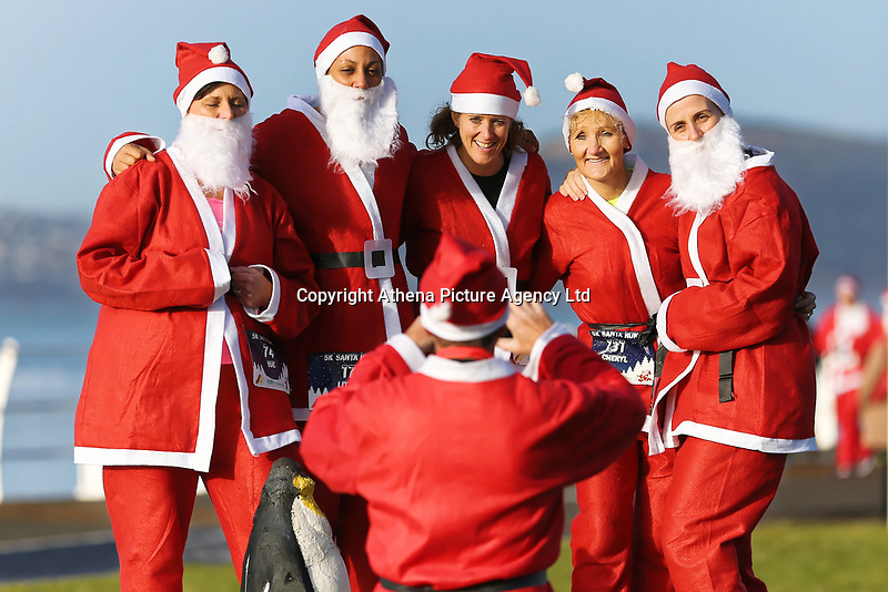 Pictured: Runners in Santa Claus fancy dress have their picture taken in this year's run in Aberavon, Wales, UK. Saturday 16 December 2017<br /> Re: 500 people have taken part in Run4All Santa 5km Run on Aberavon Promenade near Port Talbot, Wales, UK.