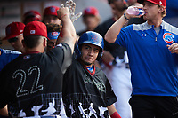 Carlos Sepulveda (27) of the Tennessee Smokies celebrates with teammate Cam Belago (22) after hitting a home run against the Chattanooga Lookouts at Smokies Stadium on July 31, 2021, in Kodak, Tennessee. (Brian Westerholt/Four Seam Images)