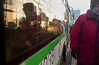People walk past buses with police as they enter Lubyanka Square for an unsanctioned anti-Putin demonstration in Moscow, Russia.  Police arrested a number of protesters and opposition leaders.