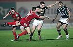 Andy Fenby tackles Dave McSharry..RaboDirect Pro12.Scarlets v Connacht.02.03.12.©STEVE POPE