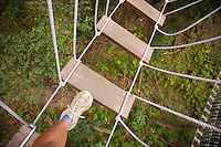 Walking on bridge to platform while Ziplining on the Big island with Kohala zipline
