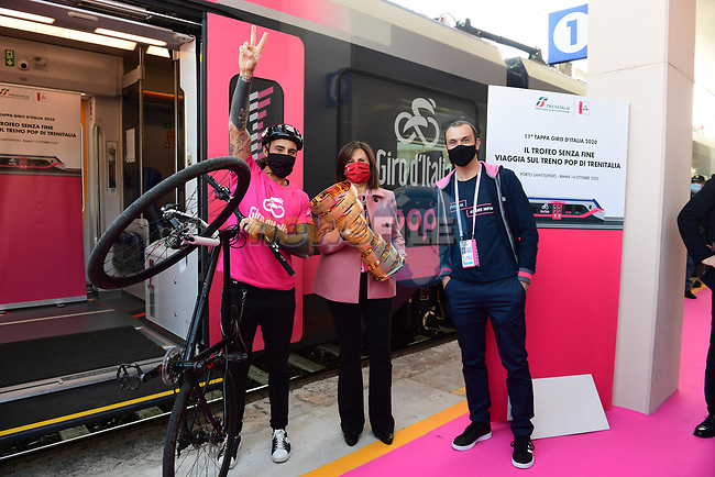 Vittorio Brumotti, Sabrina De Filippis, Director of the Regional Passenger Division of Trenitalia and Ivan Basso with the Trofeo Senza Fine which will travel today from Porto Sant'Elpidio to Rimini on a convoy with a pink livery in honour of the Corsa Rosa before the start of Stage 11 of the 103rd edition of the Giro d'Italia 2020 running 182km from Porto Sant'Elpidio to Rimini, Italy. 14th October 2020.  <br /> Picture: LaPresse/Jennifer Lorenzini | Cyclefile<br /> <br /> All photos usage must carry mandatory copyright credit (© Cyclefile | LaPresse/Jennifer Lorenzini)