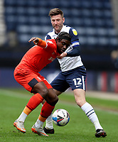 20th March 2021; Deepdale Stadium, Preston, Lancashire, England; English Football League Championship Football, Preston North End versus Luton Town; Paul Gallagher of Preston North End competes for the ball with Pelly Ruddock of Luton Town