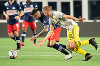 FOXBOROUGH, MA - MAY 16: Sebastian Berhalter #18 Columbus SC pressures Gustavo Bou #7 of New England Revolution during a game between Columbus SC and New England Revolution at Gillette Stadium on May 16, 2021 in Foxborough, Massachusetts.