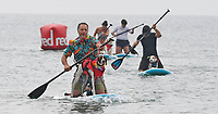 BNPS.co.uk (01202 558833)<br /> Pic: ZacharyCulpin/BNPS<br /> <br /> Putting their best paw forward hoping to ride the wave of success - Competitors and their dogs take part in the annual Dog Surfing championships. <br /> <br /> The event known as The 'dogmasters' took place today on Bournemouth beach in front of packed crowd, it's the country's only dog surfing and paddleboard championship.