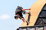 Skate boarders show off their skills during the summer X-Games at the Circuit of the Americas race track in Austin, Texas.