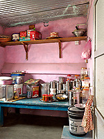 Painted pink, the pantry houses dry goods such as lentils and spices, as well as cooking oil