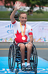 TORONTO, ON, AUGUST 8, 2015. Robert Labbe of Canada wins a bronze medal in men's road race (H1-2M) at the ParaPan Am Games in Toronto.<br /> Photo: Dan Galbraith/Canadian Paralympic Committee