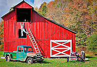 Bright red barn with antique car and tractor, with lifesize figure falling off a ladder in front of Sharp's Country Store, Slatyfork, West Virginia