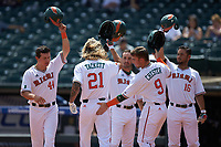 Hunter Tackett (21) of the Miami Hurricanes celebrates a run with teammates against the Georgia Tech Yellow Jackets during game one of the 2017 ACC Baseball Championship at Louisville Slugger Field on May 23, 2017 in Louisville, Kentucky. The Hurricanes walked-off the Yellow Jackets 6-5 in 13 innings. (Brian Westerholt/Four Seam Images)