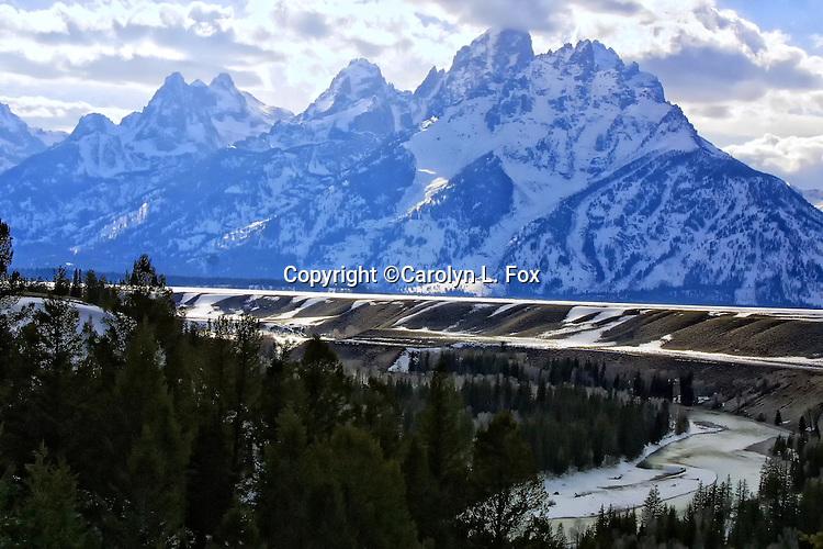 The Teton Mountain Range rises above the Snake River in Jackson Hole, Wyoming.