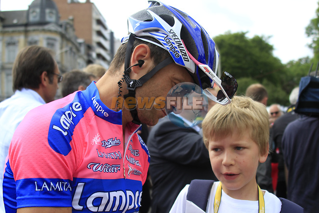 Michele Scarponi (ITA) Lampre-ISD signs an autograph for a young fan at sign on before the start of Stage 1 of the 99th edition of the Tour de France, running 198km from Liege to Seraing starting in Parc d'Avroy Liege, Belgium. 1st July 2012.<br /> (Photo by Eoin Clarke/NEWSFILE)