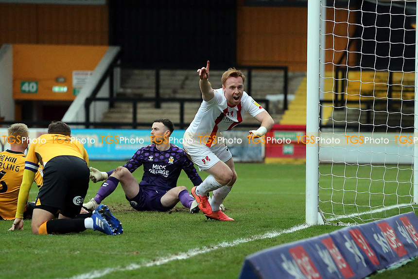 O's Danny Johnson scores for orient past Callum Burton and celebrtes during Cambridge United vs Leyton Orient, Sky Bet EFL League 2 Football at Abbey Stadium on 26th December 2020