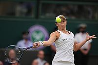 6th July 2021, Wimbledon, SW London, England; 2021 Wimbledon Championships, day 8;  Ashleigh Barty of Australia hits a return during the womens quarterfinal match
