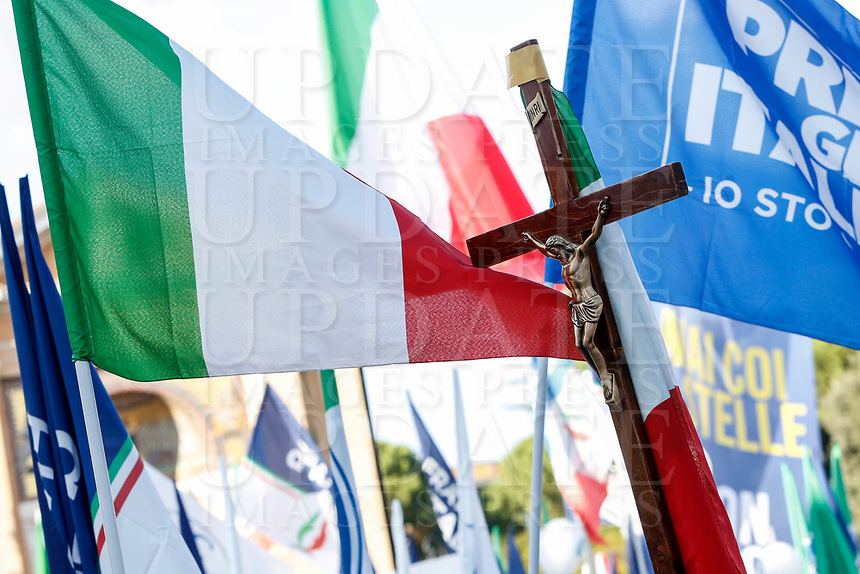 """A crucifix is seen among Italian tricolor flags during the so-called """"Italian Pride!"""" political rally attended by right parties' leaders against government's economic policies in St. John Lateran Square, Rome, Italy, October 19, 2019.<br /> Update Images Press/Riccardo De Luca"""