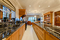BNPS.co.uk (01202) 558833. <br /> Pic: TailorMade/BNPS<br /> <br /> Pictured: Kitchen. <br /> <br /> A multi-millionaire is hoping to have a shot at selling his luxury mansion - by throwing a hi-tech golf simulator into the deal.<br />  <br /> Golf-loving Barry Bester put the waterfront property on Sandbanks, Dorset, on the market for £11m last year.<br />  <br /> He is now offering his £40,000 state-of-the-art simulator he has had built on the grounds with the sale.